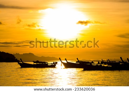 Beautiful silhouette sunrise sky at Koh Lipe island, Thailand. - stock photo
