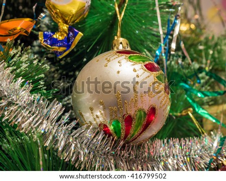 Beautiful silver Christmas ball in the branches of spruce. - stock photo
