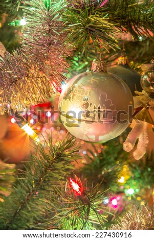 Beautiful silver glass ball with snowmen on Christmas Tree - stock photo