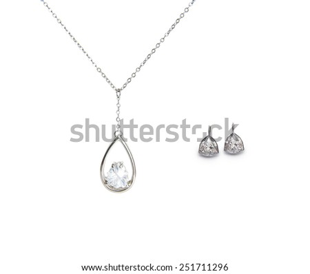 beautiful silver necklace and diamond earrings isolated on white background - stock photo