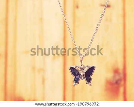 Beautiful silver necklace in a shape of butterfly with blue gems - stock photo