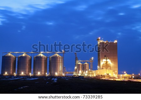 beautiful silver silos in landscape - stock photo