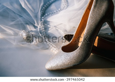 Beautiful silver wedding shoes high heel shoes with veil - stock photo