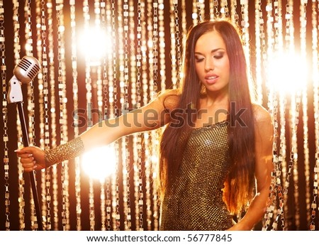 Beautiful singer on a stage - stock photo
