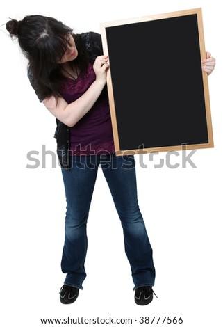 Beautiful sixteen year old highschool student with blank chalkboard. - stock photo