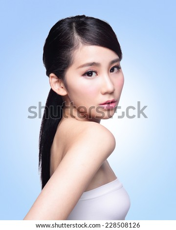 Beautiful Skin care woman Face isolated on blue background. asian Beauty - stock photo