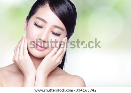 Beautiful Skin care woman Face smile and enjoy carefree isolated on nature green background. asian Beauty