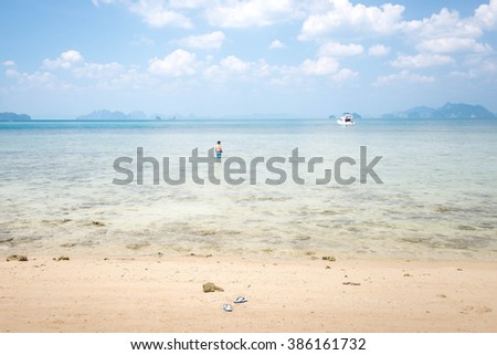 Beautiful sky and blue ocean with blurry of man and boat