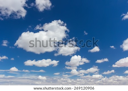 Beautiful sky and sea with white clouds. - stock photo