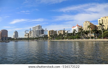 Beautiful skyline of downtown West Palm Beach, Florida, with Lake Worth in the foreground.