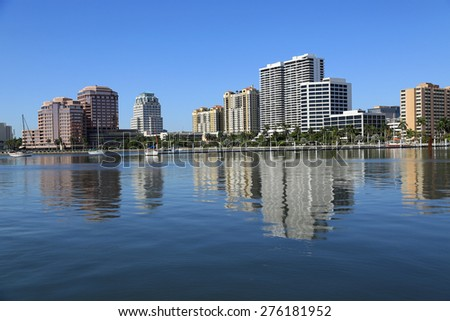 Beautiful skyline of downtown West Palm Beach with reflections in the lake - stock photo