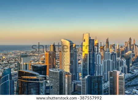 Beautiful skyline with modern architecture at sunset. Aerial view of Dubai business bay towers.