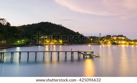 Beautiful skylines over coastline wooden jetty night view