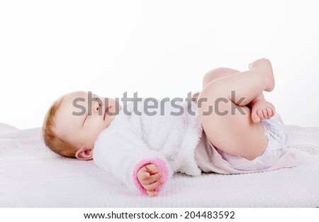 Beautiful sleeping baby on a white background