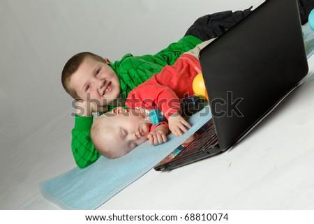 beautiful sleeping baby with laptop - stock photo