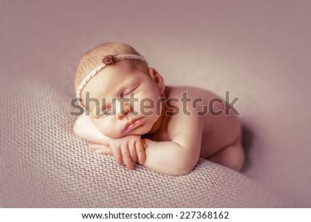 Beautiful sleeping newborn - stock photo