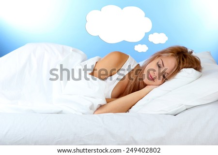 Beautiful sleeping young woman and space for text in cloud - stock photo