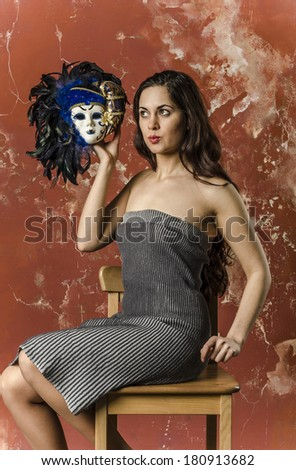 beautiful slender brunette actress talking with venetian mask
