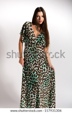 Beautiful slender Ukrainian woman in a leopard print dress