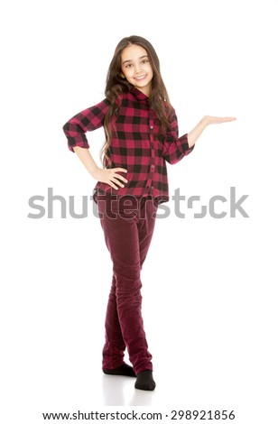 Beautiful, slender young girl Oriental appearance with long dark hair in corduroy skinny jeans and a plaid shirt features a hand towards-Isolated on white background - stock photo