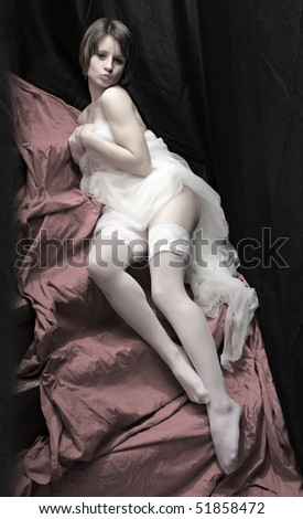 Beautiful slenderness young girl in bridal veil on pink background. Vintage style low key studio shot. Great for calendar. - stock photo