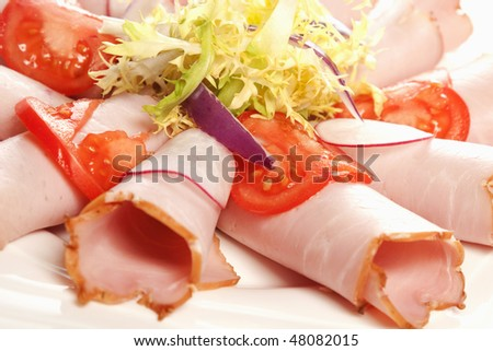 Beautiful sliced bacon  with some vegetables