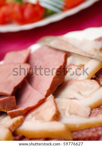 Beautiful sliced food arrangement with some vegetables. Shallow depth-of-field