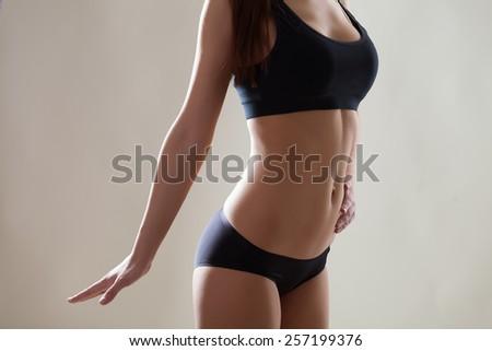 Beautiful slim body of woman - stock photo