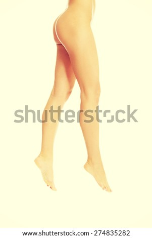 Beautiful slim long woman legs - stock photo