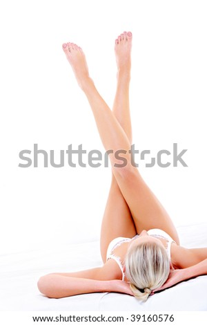 Beautiful slim long woman legs directed up over white background - stock photo