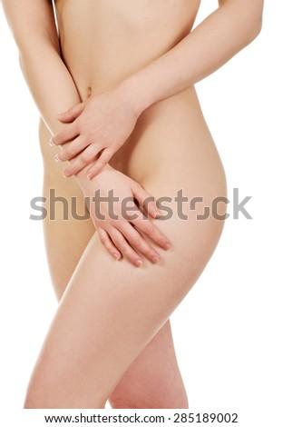 Beautiful slim naked woman's body. - stock photo