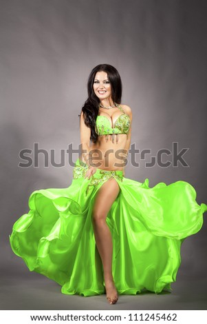 beautiful slim woman bellydancer sexy arabian turkish oriental professional artist in carnival shining costume with long glossy hair.alluring brunette girl exotic star of bellydance in diamond jewelry - stock photo