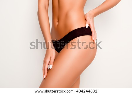 Beautiful slim woman body with tan isolated on white background - stock photo