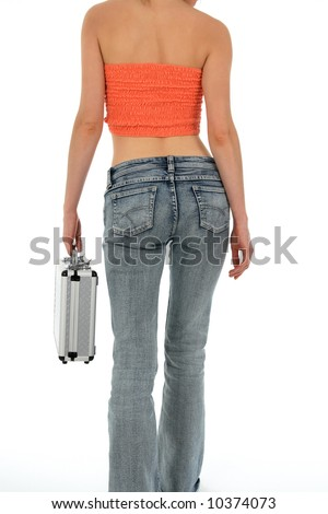 Beautiful slim woman in blue jeans carrying a metal case. - stock photo