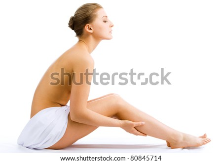 Beautiful slim woman in spa center on white background - stock photo