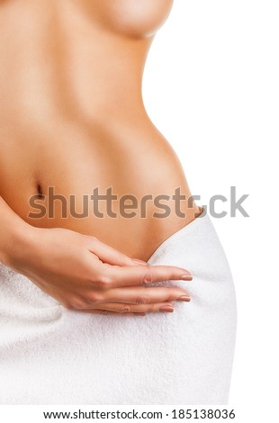Beautiful slim woman's body isolated on white background - stock photo