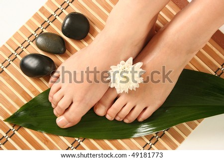 beautiful slim woman's legs and stones