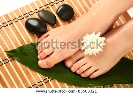 beautiful slim woman's legs and stones - stock photo
