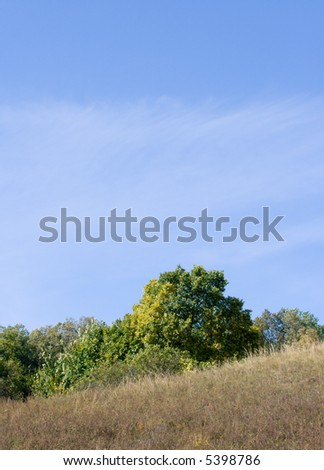 Beautiful slope on a background of the blue sky. A fine background.