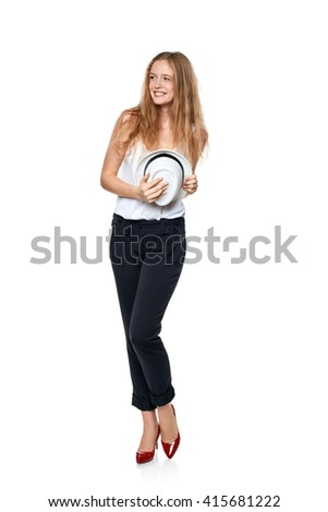 Beautiful slytish woman in full length laughing smiling to the side at blank copy space and holding fedora hat, over white background - stock photo