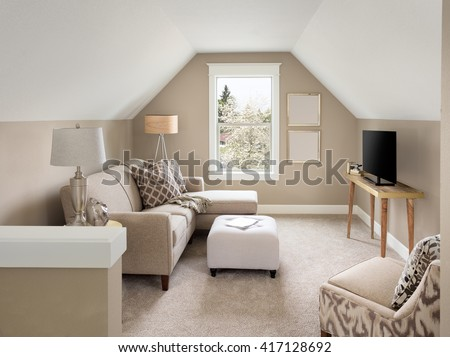 Beautiful small living room interior and loft in new home with sloping roof - stock photo