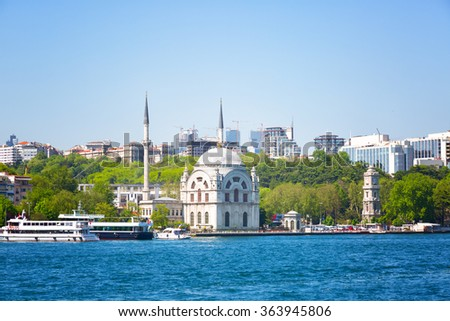 Beautiful small mosque stands on the banks of the Bosphorus, Istanbul - stock photo