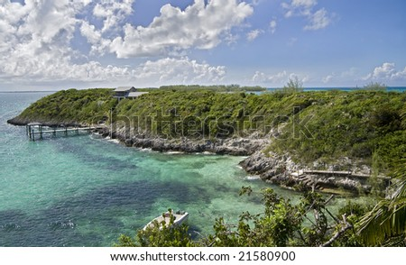 Beautiful small tropical island covered with lush green vegetation. - stock photo