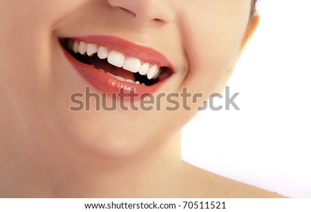 Beautiful smile of a woman over white background