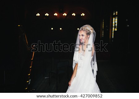 Beautiful smile of the bride in the white lace dress - stock photo
