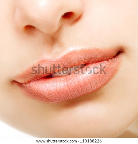 Beautiful smile of young fresh woman. Female lips closeup. Isolated over white background. - stock photo