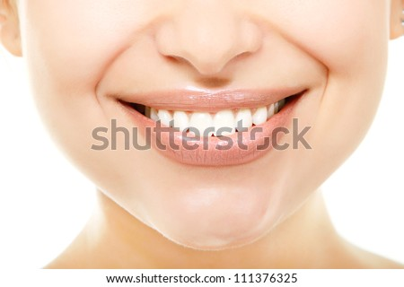 Beautiful smile of young fresh woman with great healthy white teeth. Isolated over white background