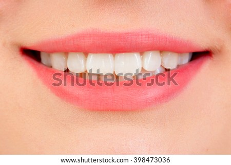 Beautiful smile with white teeths and pink lips - stock photo