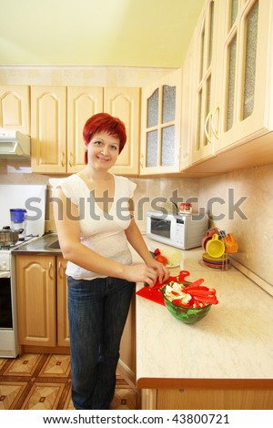 beautiful smile women in kitchen - stock photo
