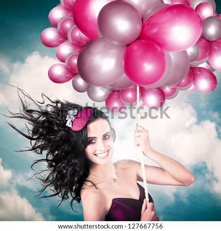 Beautiful Smiling Australian Girl Flying High Wearing Headpiece With Balloons In A Depiction Of The Fashion Of The Field During The Melbourne Cup Spring Carnival Horse Racing Festival - stock photo